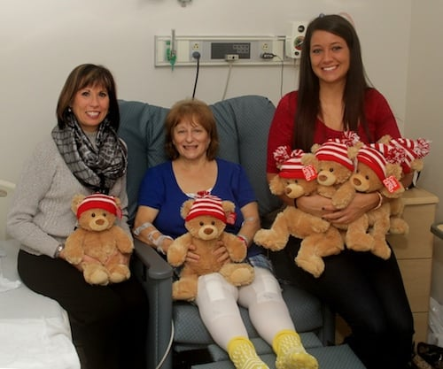 Monongahela Valley Hospital's Orthopedic Institute Coordinator Lorraine Damich, RN, BSN, CPAN, (left) and donation coordinator Brittany Fagioletti, (right) deliver bears to the hospital's Orthopedic Institute joint replacement patients. Barb Duranti, of Donora, is recovering from double-knee replacement surgery and said she was surprised with the Gund bear gift. It was one of 144 donated by Aéropostale stores in Washington, Greensburg and Pittsburgh.