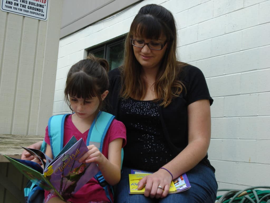 backpack recipient reading w mom
