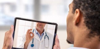 Telemedicine and health care concept with a young man and a doctor on computer screen