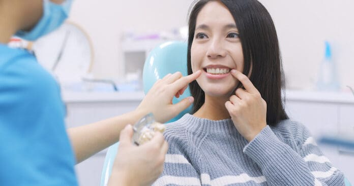 Woman talk to dentist in dental clinic