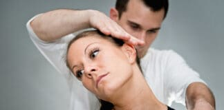 Chiropractic adjustment - Chriopractor working on patient's neck