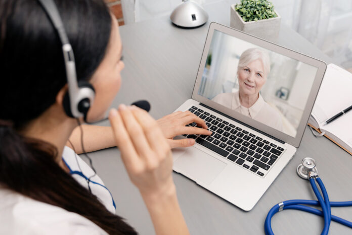Doctor talking with a senior patient. Telemedicine concept