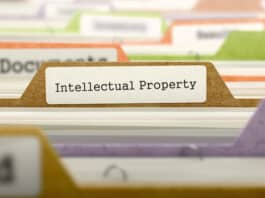 Intellectual Property - Folder Register Name in Directory. Colored, Blurred Image. Closeup View.